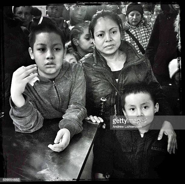 Families wait in line for a donated toy for Chrstmas at the offices of the BedStuy Campaign Against Hunger