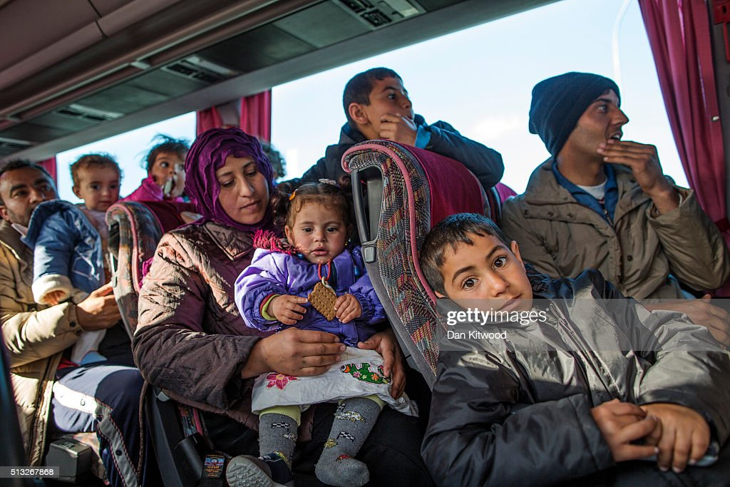 Families wait on a bus as they travel north from Athens to the Greek-Macedonia border on March 2, 2016 in Polikastro, Greece. The transit camp at the border is becoming increasingly overcrowded as thousands of refugees continue to arrive from Athens and the Greek Islands. Macedonia's border with Greece remains 'open' but after allowing 580 refugees a day to cross into the country at the beginning of the week, the numbers passing have fallen dramatically with only a handful every day. According to local authorities approximately 10,000 refugees and migrants now remain stuck at the border as they wait to enter Macedonia to continue their journey North into Western Europe.