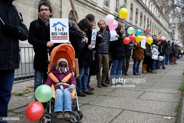 Families waiting to adopt children from the Democratic Republic of Congo demonstrate at the Mission d'adoption internationale headquarters in Paris...