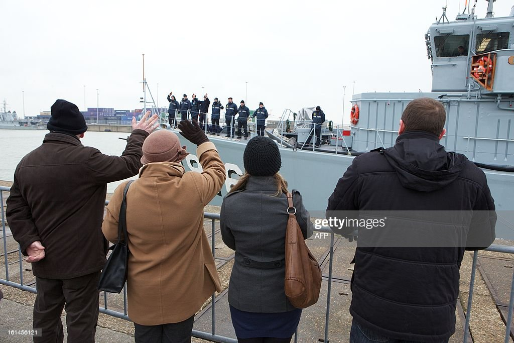 Families wave as the BNS Bellis mine-sweeper leaves on February 11, 2013 the port of Zeebrugge to join the North Atlantic Treaty Organzation mine-hunting program SNMCMG1 in northern European waters.