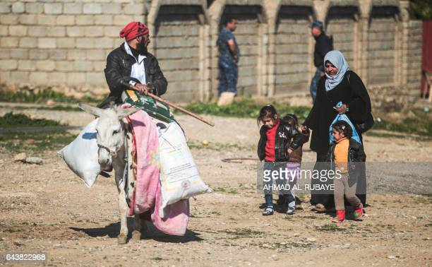Families who have fled across the front lines south of Mosul arrive in the village of alBuseif south of Mosul during an offensive by Iraqi forces to...