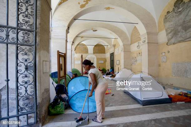 Families with children in the colonnade of the Basilica on August 13 2017 in Rome Italy Many families were evicted from a building in Quintavalle...