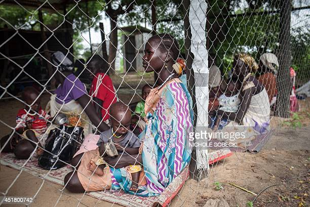 Families with malnourished children wait to receive treatment at the Leer Hospital South Sudan on July 7 2014 Hundreds of thousands of people were...