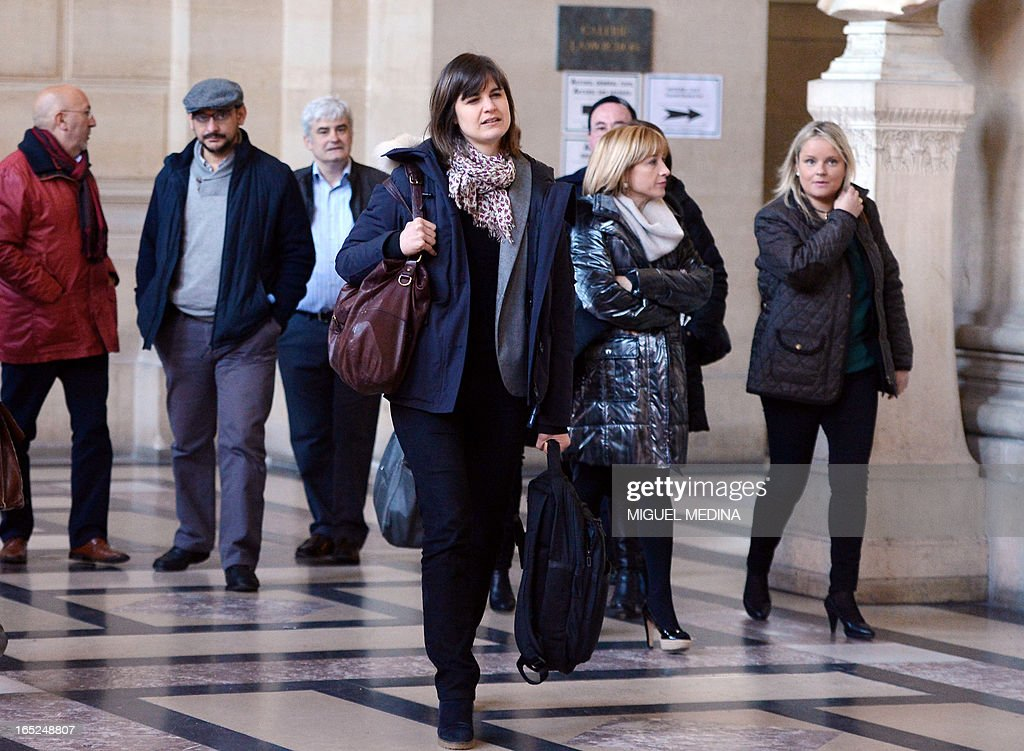 Famillies of victims arrives at Paris' courthouse to attend the trial of three people thought to be members of the Basque separatist group ETA over the killing of two Spanish civil guards in 2007, on April 2, 2013. AFP PHOTO / MIGUEL MEDINA