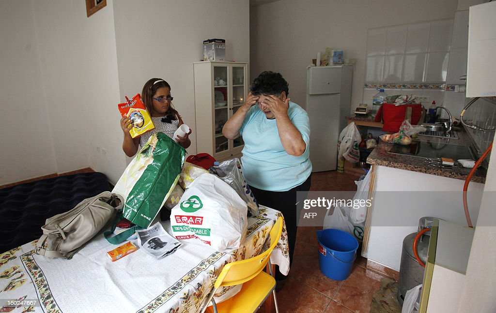 A familly gets ready for evacuation in Vallehermoso, on August 13, 2012, on the Spanish canary island of La Gomera. Wildfires killed two people in southeastern Spain and forced thousands to evacuate in the Canary Islands where flames ravaged a rare nature reserve, authorities said Monday.