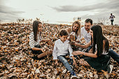 Family Adventure in Autumn Leaves at Park