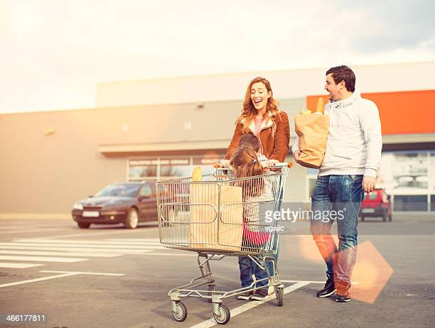 Family after shopping on parking lot.