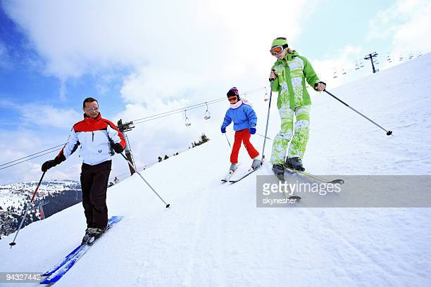 Family all together skiing.