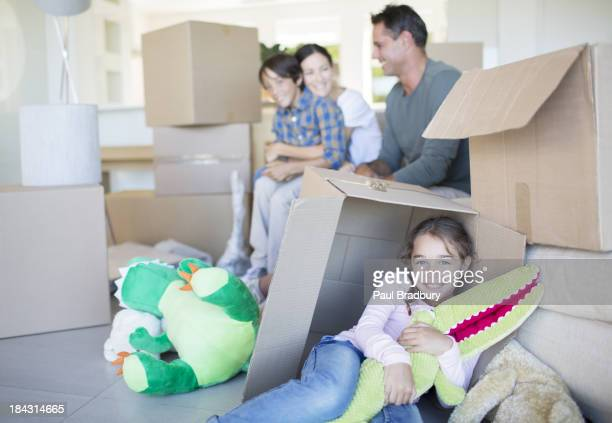 Family among cardboard boxes in livingroom