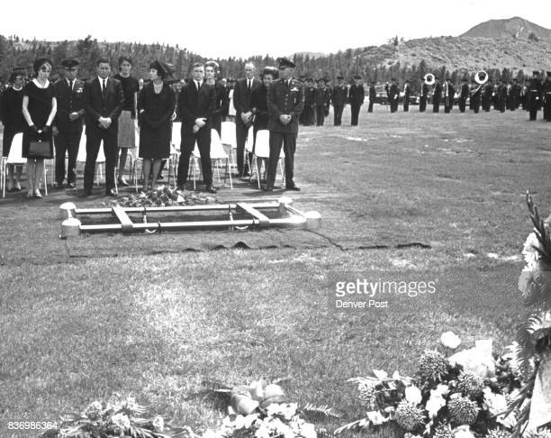 Family and close associates of General Blanchard stand at the grave Behind them are Air Force officers the Air Force Academy band and an honor flight...