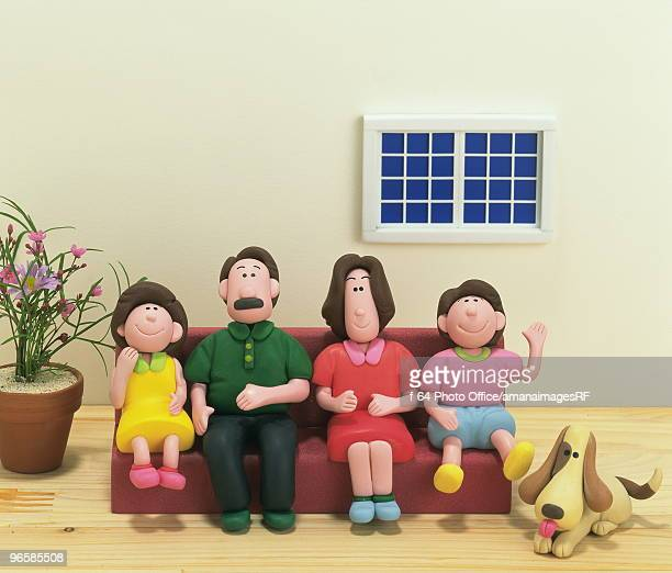 Family and dog, made of clay