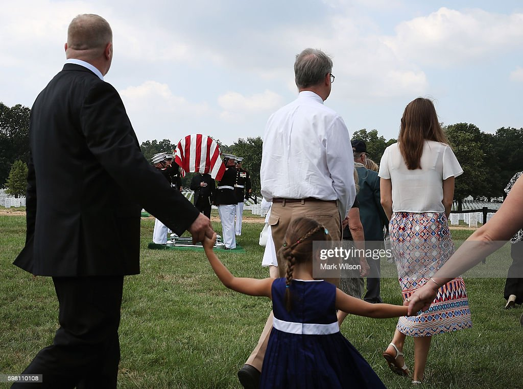 Family and friends attend the full honors burial service for US Marine PFC Anthony Brozyna of Hartford CT at Arlington National Cemetary August 31...