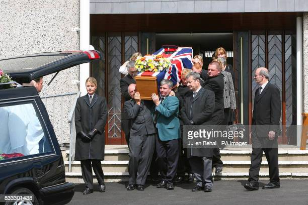 Family and friends attend the funeral of Northern Irish soldier Lance Corporal Timothy Darren Flowers killed in Basra Southern Iraq at Burnside...