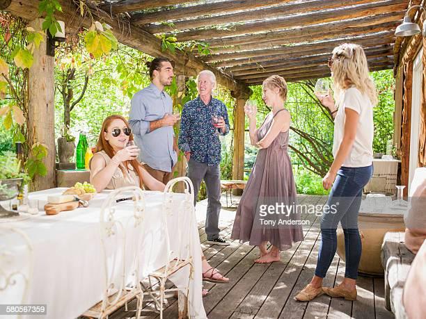 Family and friends celebrating on veranda
