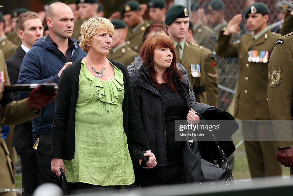 Family and friends follow a military procession during a Military Commemorative Service for LCPL Durrer and LCPL Malone at Burnam Military Camp on August 11, 2012 in Christchurch, New Zealand. The bodies of the two New Zealand soldiers killed in Afghanistan arrived in Christchurch last night. Private funeral services will then be held by their families.