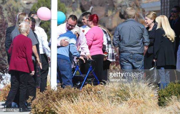 Family and friends greet each other as they arrive at the chapel of the Church of Jesus Christ of LatterDay Saints for the funeral of Heather...