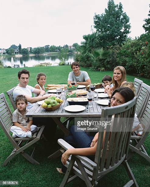 Family and friends having a meal outside