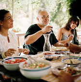 family and friends having garden dinner