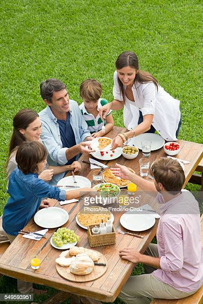 Family and friends having picnic while on vacation