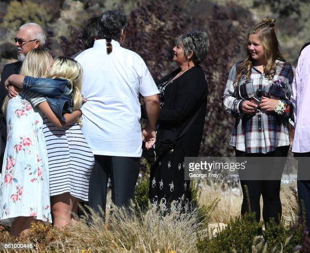 Family and friends hug and greet each other as they arrive at the chapel of the Church of Jesus Christ of LatterDay Saints for the funeral of Heather...