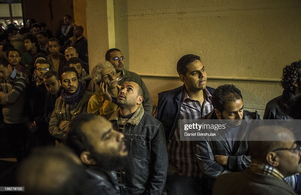 Family and friends of killed journalist El-Hosseiny Abou-Deif wait for his body to be carried out from a morgue on December 12, 2012 in Cairo, Egypt. Egyptian journalist El-Hosseiny Abou-Deif who was hit in the head with a rubber bullet in last week's clashes at the presidential palace, was announced dead on Wednesday after spending a week in a coma. Anti-Morsi protesters were quiet after continued demonstrations across Egypt against the country's draft constitution, rushed through parliament in an overnight session on November 29. The country's new draft constitution, passed by a constitutional assembly dominated by Islamists, will go to a referendum on December 15.