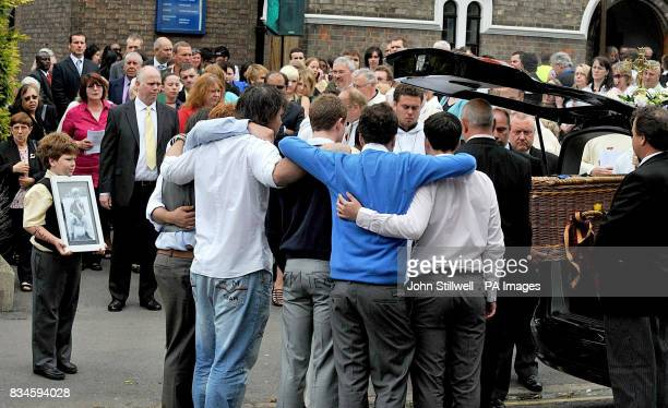 Family and friends of murdered schoolboy Jimmy Mizen gather as his coffin is removed from Our Lady of Lourdes church in Lee southeast London