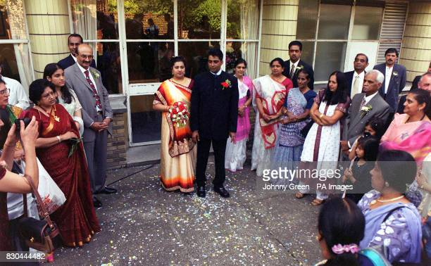 Family and friends of Ravi Ram 38 with his 24yearold wife Mamta outside the Registry Office at Brent Council in north London after they took their...
