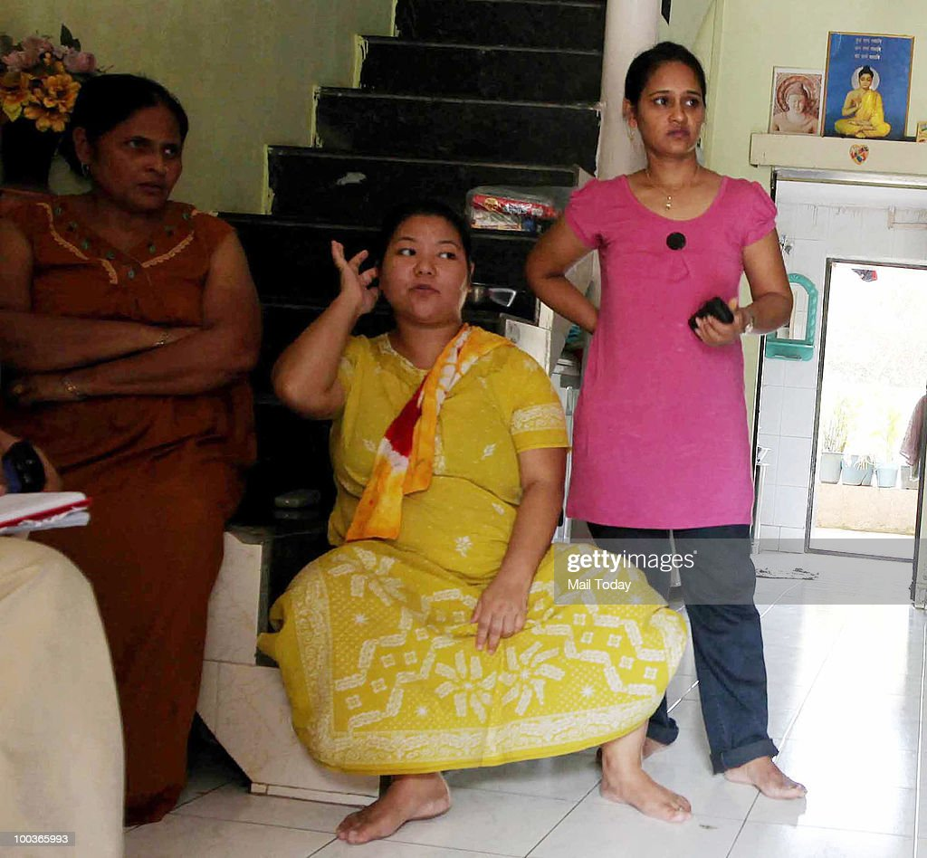 Family and friends of Sujata Surveshi, a senior cabin crew member of the Air India aircraft , who died in the Mangalore air crash, at her residence in Mumbai on May 22, 2010.