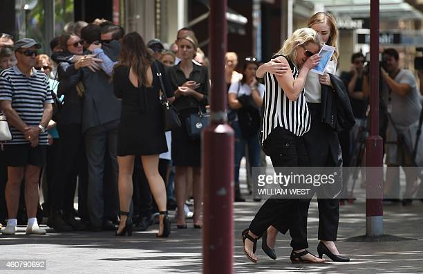 Family and friends of Sydney siege victim Tori Johnson leave after a funeral service in Sydney on December 23 2014 A private funeral was held for...