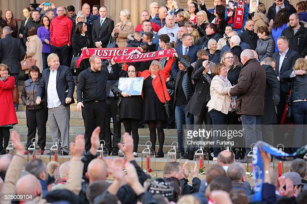 Family and friends of the victims on the steps join thousands of people outside Liverpool's Saint George's Hall to attend a vigil for the 96 victims...