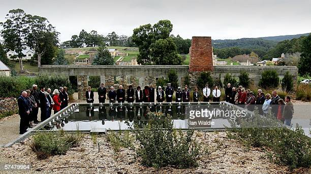 Family and friends of those killed in the Port Arthur massacre lay floating candles in the reflection pool at the memorial site during a memorial...