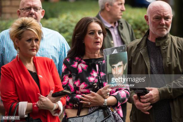 Family and friends of those who died in the 1989 Hillsborough football stadium disaster stand together as retired police officer Donald Denton...