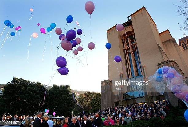 Family and friends release ballons after attending the memorial for triplets Lillie Willsher and Jackson Weekes at the Wellington Cathedral of St...