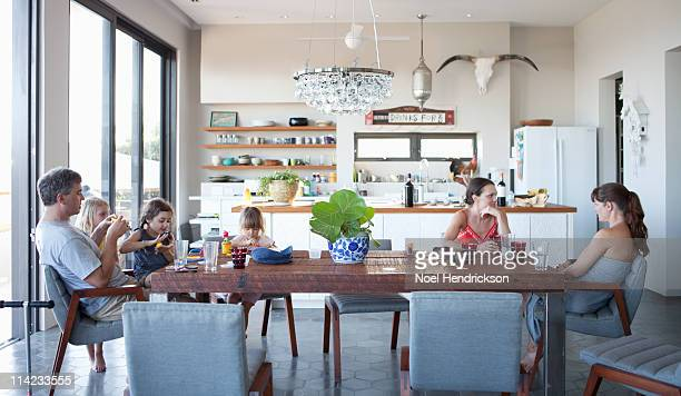 family and friends sitting around a dining tabl