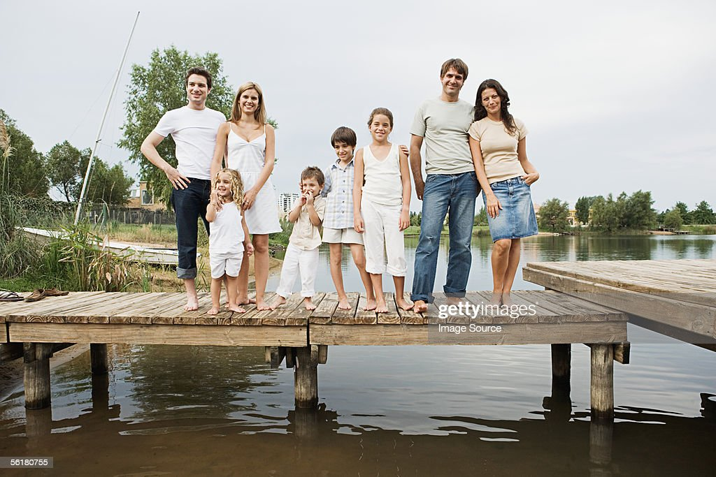 Family and friends standing on a pier : Stock Photo