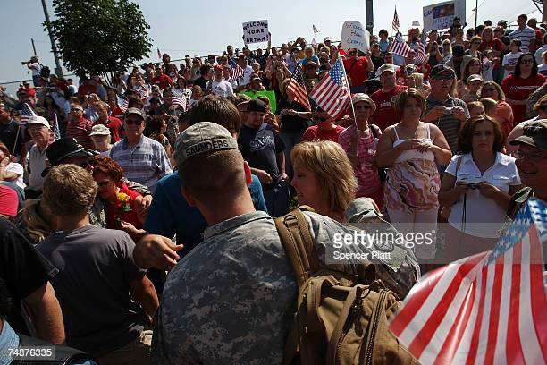 Family and friends that numbered in the hundreds attend a welcome home ceremony for troops with the Nebraska Army National Guard back from Iraq June...