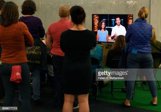 BOULDER CO OCTOBER 1 Family and friends watch Megan and Scott Reamer promote Jackson's Honest potato chip company on the television during the...