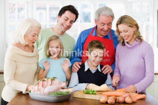 family anticipating british christmas dinner stock photo - British Christmas Dinner