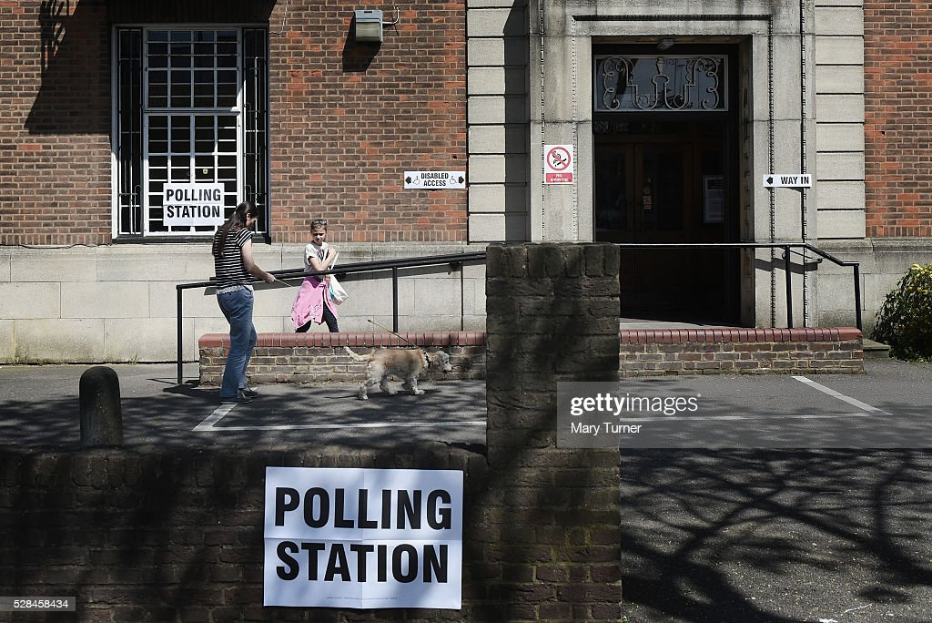 A family arrive with their dog at the East End Road polling station to vote in the London Mayoral and Assembly Elections, on May 5, 2016 in East Finchley, United Kingdom. Today,dubbed 'Super Thursday',sees the British public vote in countrywide elections to choose members for the Scottish Parliament, the Welsh Assembly, the Northern Ireland Assembly, Local Councils, a new London Mayor and Police and Crime Commissioners. There are around 45 million registered voters in the UK and polling stations open from 7am until 10pm.