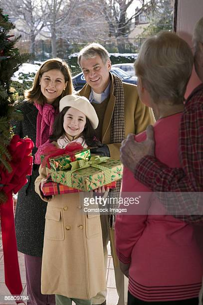 Family arriving with Christmas gifts