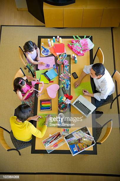 family art projects at table, overhead view