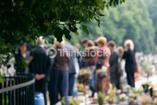 Family at a burial : Stock Photo