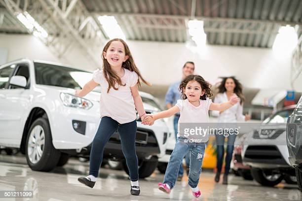 Family at a car dealership