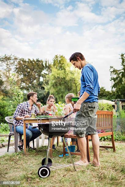 Family At Barbeque In Garden