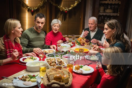 Family At Christmas Dinner Stock Photo   Getty Images