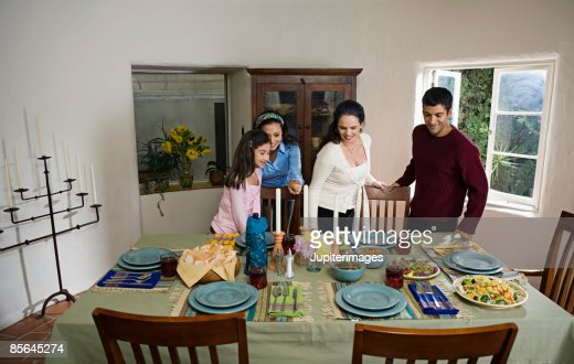 Family at dining table stock photo getty images for Best dining tables for families