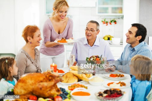 Family At Dinner Table For The Thanksgiving Day Stock
