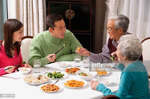 Family at dinner table having traditional food