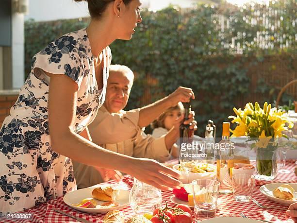 Family at dinner table in garden