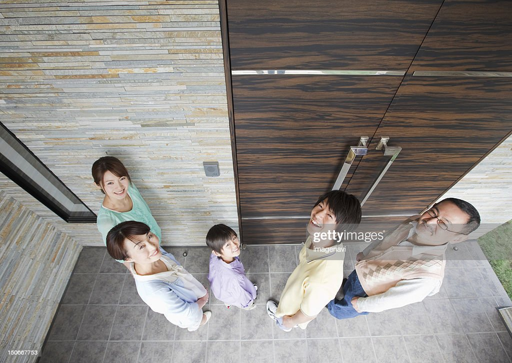 Family at front door : Stock Photo